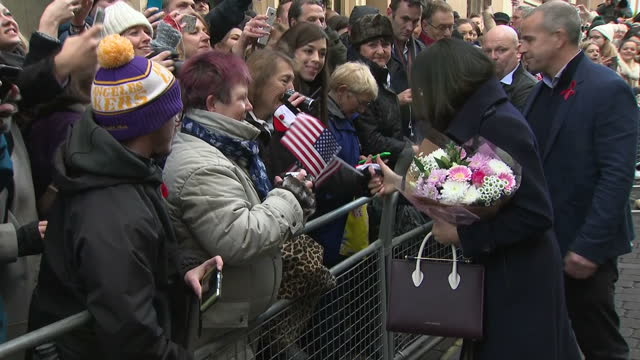 Exterior shots of Prince Harry and Meghan Markle greeting members of the public lining the street on December 01 2017 in Nottingham United Kingdom