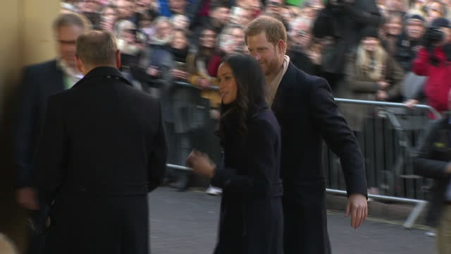 Exterior shots of Prince Harry and Meghan Markle greeting members of the public lining the street in Nottingham before arriving at the Nottingham...