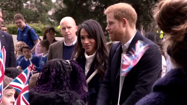 Exterior shots of Prince Harry and Meghan Markle greeting members of the public and schoolchildren gathered outside Millennium Point in Birmingham...