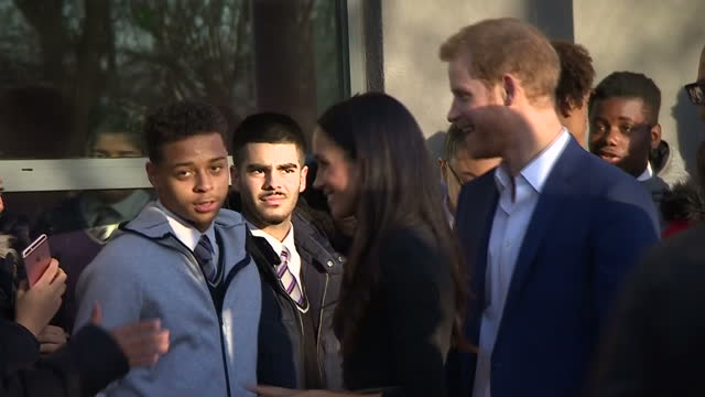 Exterior shots of Prince Harry and Meghan Markle greeting pupils and staff outside Nottingham Academy during a visit to meet with staff from the...
