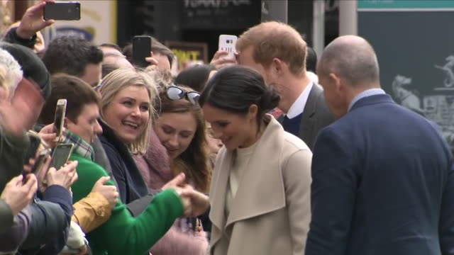 exterior shots of prince harry and meghan markle on a walkabout of belfast meeting members of the public on 23 march 2018 in belfast northern ireland - ireland stock videos & royalty-free footage