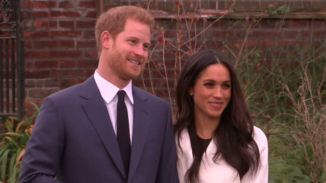 exterior shots of prince harry and meghan markle posing together for a photocall in the gardens of kensington palace following the announcement of... - fototermin stock-videos und b-roll-filmmaterial