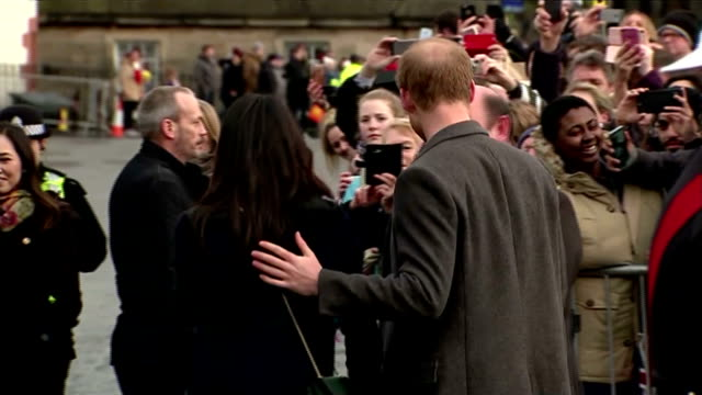 Exterior shots of Prince Harry and Meghan Markle speaking to officials outside Edinburgh Castle before getting into a vehicle to travel to their next...