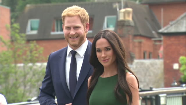 exterior shots of prince harry and meghan markle wax work displayed outside windsor castle on eton bridge including shots of fans and public members... - wax stock videos & royalty-free footage