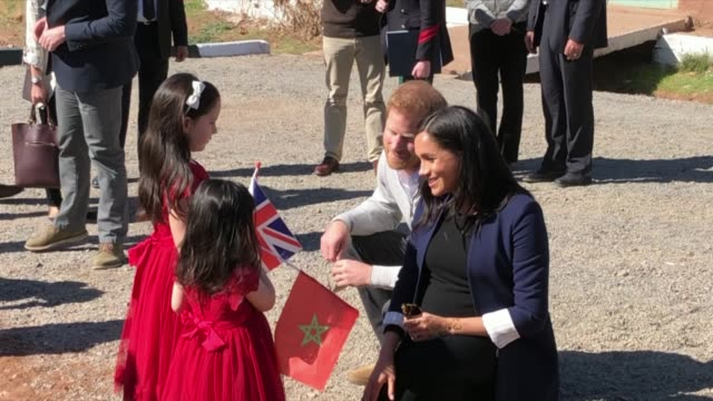 exterior shots of prince harry and meghan walking in rural morocco and meeting two young girls on 24 february 2019 in asni morocco - gender equality stock videos & royalty-free footage