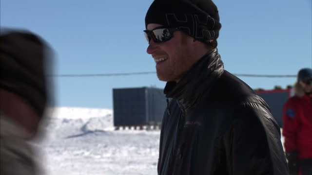 vídeos de stock, filmes e b-roll de exterior shots of prince harry and other members of the walking with the wounded south pole allied challenge sorting packs of ski equipment during... - ski pole