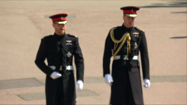 exterior shots of prince harry and prince william arrive at windsor castle, get out of a vehicle and begin walking along the path towards st george's... - guest stock videos & royalty-free footage