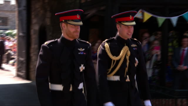Exterior shots of Prince Harry and Prince William walk along the grounds of Windsor Castle as they arrive at St George's Chapel Including shots of...