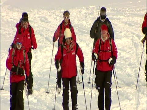 exterior shots of prince harry and walking with the wounded arctic team skiing walking across snow covered hills joking around with each other prince... - other stock videos & royalty-free footage