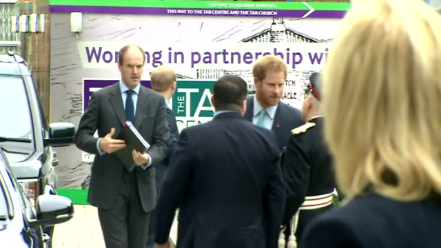 exterior shots of prince harry arriving at mildmay hospital and shake hands with members of the public on december 14, 2015 in london, england. - retrovirus video stock e b–roll