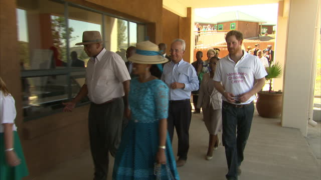 exterior shots of prince harry arriving at the sentebale children's home on november 26 2015 in maseru lesotho - waisenhaus stock-videos und b-roll-filmmaterial