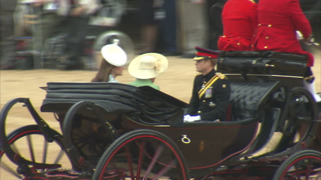 exterior shots of prince harry camilla duchess of cornwall and catherine duchess of cambridge arriving by carriage at horse guards parade for the... - carriage stock videos & royalty-free footage