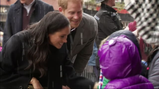 exterior shots of prince harry, duke of sussex and meghan, duchess of sussex talking to a group of local children from abbeywood nursery on 1st... - bristol england stock videos & royalty-free footage