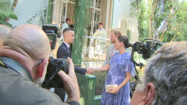 Exterior shots of Prince Harry Duke of Sussex and Meghan Duchess of Sussex arriving for audience with King Mohammed VI of Morocco and being greeted...