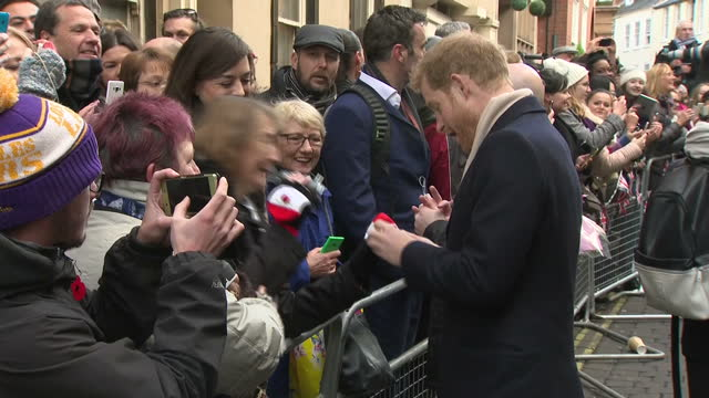 Exterior shots of Prince Harry greeting members of the public lining the streets in Nottingham admiring the mittens and hats of some of the...