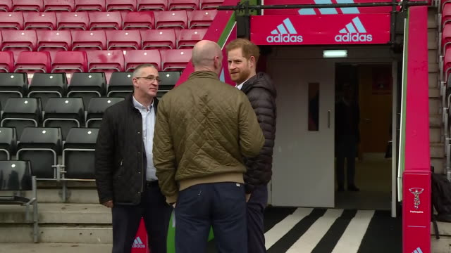 exterior shots of prince harry hugging former wales rugby captain gareth thomas on the pitch of twickenham stoop and meeting others at an event ahead... - gareth thomas rugby player stock videos & royalty-free footage