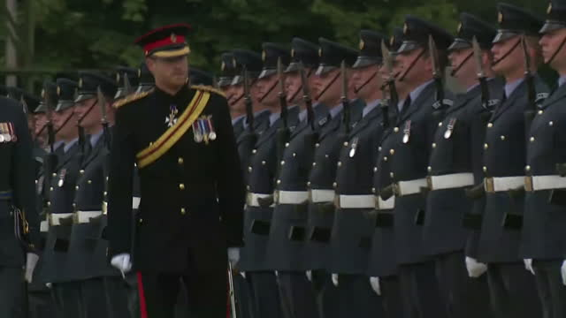 exterior shots of prince harry inspecting raf personnel on parade at raf honingsby during a ceremony to present the raf regiment with a new colour in... - military stock videos & royalty-free footage