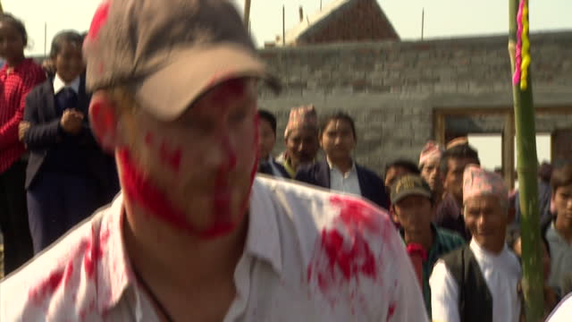 exterior shots of prince harry joining in with local holi celebrations during a visit to okhari, being smeared with brightly coloured paint and... - nepal stock videos & royalty-free footage