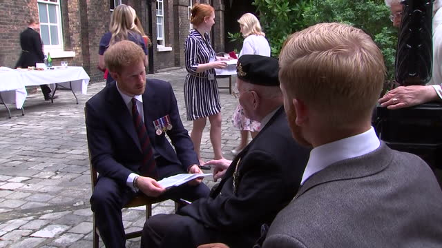 Exterior shots of Prince Harry meeting a group of WW2 veterans on 13 July 2017 in London United Kingdom