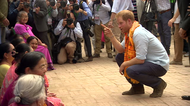 exterior shots of prince harry meeting members of the local community during a visit to patan durbar square>> on march 20 2016 in kathmandu nepal - nepal stock-videos und b-roll-filmmaterial