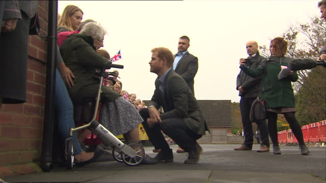 Exterior shots of Prince Harry meeting people at the reopening of the village hall on 23 October 2017 in St Michael's on Wyre United Kingdom