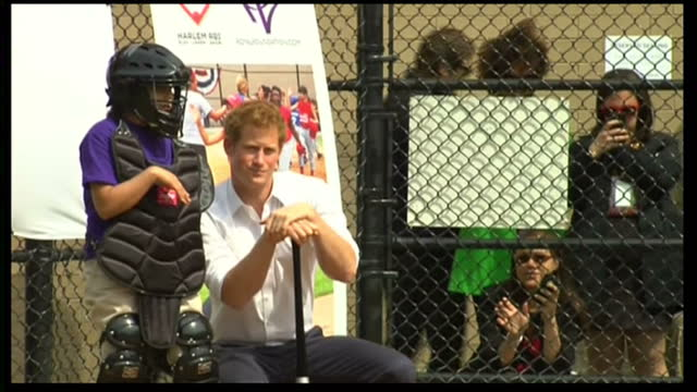 Exterior shots of Prince Harry playing baseball and speaking to catcher before hitting throw from pitcher Prince Harry playing baseball on May 14...