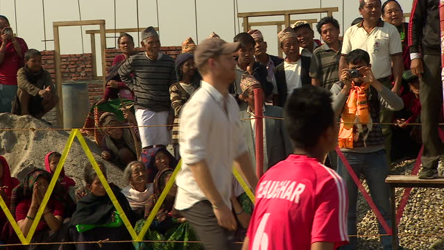 exterior shots of prince harry playing volleyball during a visit to okhari and crowds of local villagers looking on >> on march 22 2016 in okhari... - nepal stock-videos und b-roll-filmmaterial