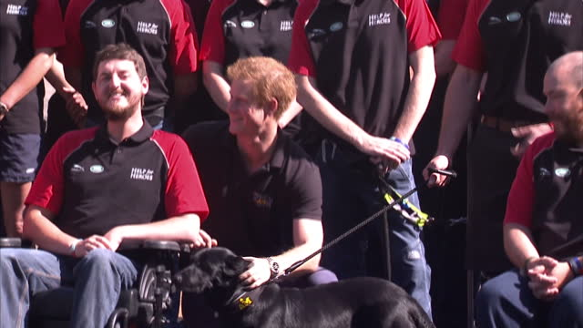 Exterior shots of Prince Harry posing for a photo opportunity with the British Armed Forces team at a publicity event ahead of the Invictus Games>>...