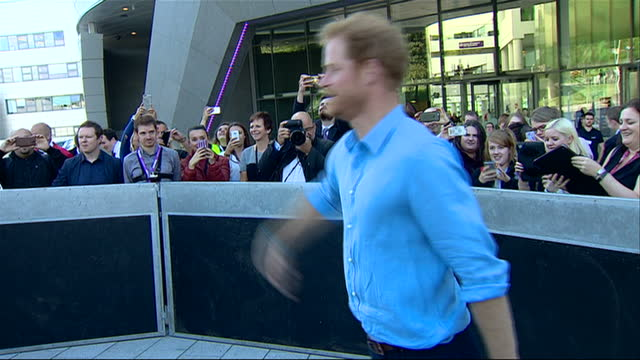 Exterior shots of Prince Harry practicing football tackles with volunteer Nordean Elouissi on his visit to the Streetsport Initiative Robert Gordon...