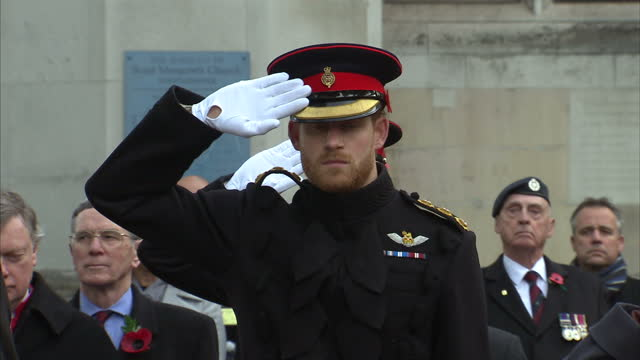 vidéos et rushes de exterior shots of prince harry saluting as the last post is played during a ceremony at the field of remembrance outside westminster abbey on... - cérémonie