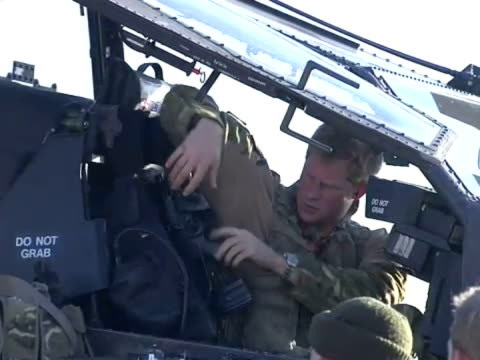 exterior shots of prince harry sitting in cockpit of apache helicopter sorting out kit and equipment after flight prince harry in apache helicopter... - apache helicopter stock videos and b-roll footage