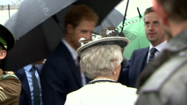 exterior shots of prince harry speaking to guests at a garden party at hillsborough castle hosted by the secretary of state for northern ireland... - prince stock videos & royalty-free footage