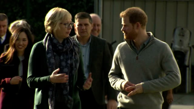 Exterior shots of Prince Harry speaking to staff and coaches and watching a children's sports activity session during a visit to a Fit and Fed...