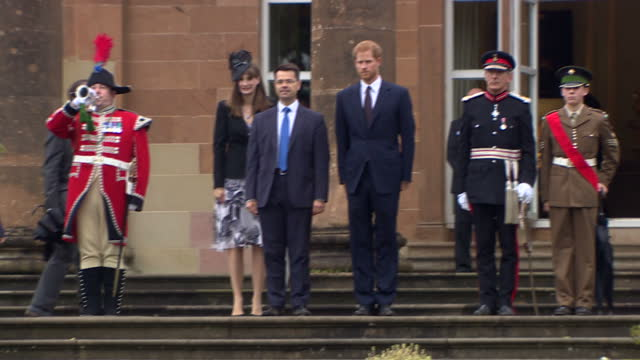 vídeos de stock, filmes e b-roll de exterior shots of prince harry walking up steps from the grounds of hillsborough castle after attending a garden party hosted by northern ireland... - irlanda do norte