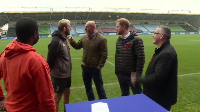 exterior shots of prince harry with former wales rugby captain gareth thomas on the pitch of twickenham stoop meeting others and inspecting hiv... - レトロウィルス点の映像素材/bロール