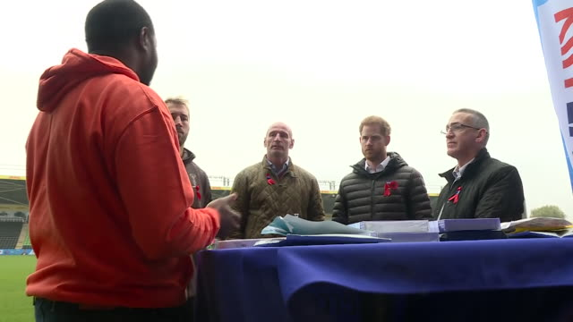 exterior shots of prince harry with former wales rugby captain gareth thomas on the pitch of twickenham stoop meeting others and inspecting hiv... - gareth thomas rugby player stock videos & royalty-free footage