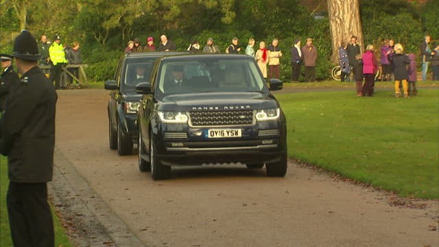 Exterior shots of Prince Philip Duke of Edinburgh arriving at Church in Land Rover and wide shots of him walking to Church for Christmas Day Service...