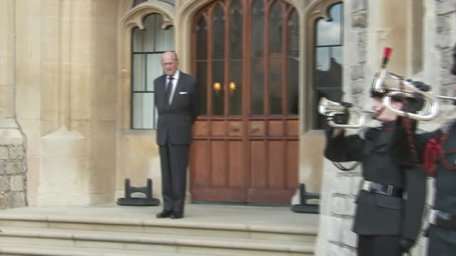 exterior shots of prince philip, the duke of edinburgh, at windsor as four buglers of the rifles' military band mark his arrival, in a ceremony... - rifle stock videos & royalty-free footage