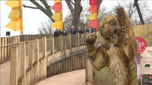 exterior shots of prince philip walking through london zoo past tiger statue before greeting and speaking to london zoo officials. prince philip... - zoo stock videos & royalty-free footage