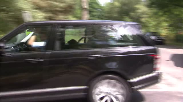 Exterior shots of Prince William and Catherine Duchess of Cambridge arriving in Bucklebury in Land Rover jeeps and drive down road Royal Baby Named...