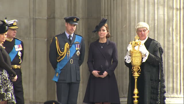 Exterior shots of Prince William and Catherine Duchess of Cambridge standing together on the steps of St Paul's Cathedral after attending a memorial...
