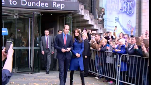 Exterior shots of Prince William and Catherine Duchess of Cambridge walking from Dundee Repertory Theatre past waiting crowds before departing in a...