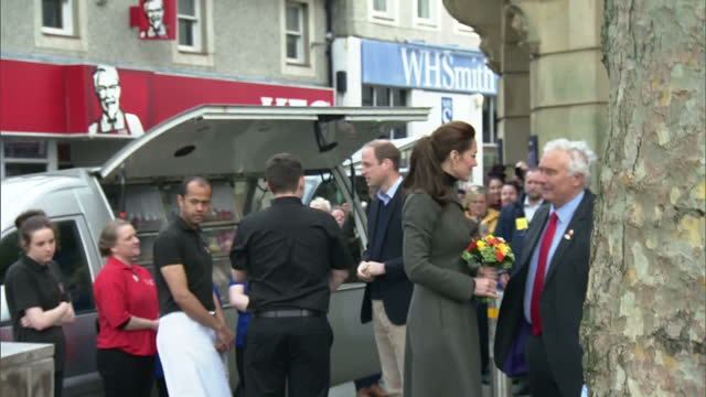 Exterior shots of Prince William and Catherine Duchess of Cambridge meeting crowds of people on a visit to Caernarfon before departing in a Range...
