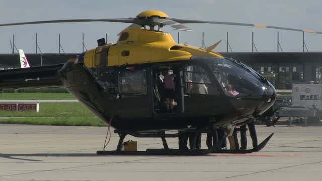 Exterior shots of Prince William and Catherine Duchess of Cambridge with children Prince George and Princess Charlotte inspecting a helicopter whilst...