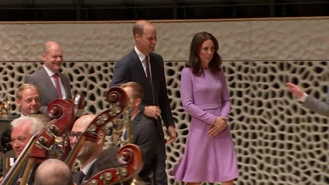 Exterior shots of Prince William and Catherine Duchess of Cambridge on a visit to Hamburg Symphony Orchestra stood on stage during a musical...
