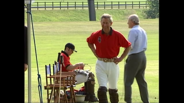 exterior shots of prince william and harry polishing boots and getting ready for a polo match as prince charles stands by, on 20 june 2003 in... - sports activity stock videos & royalty-free footage