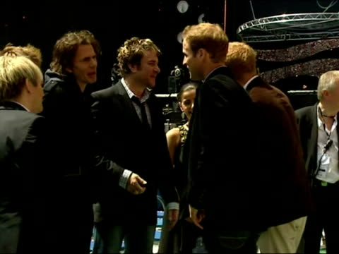 stockvideo's en b-roll-footage met exterior shots of prince william and harry shaking hands and chatting with duran duran before the live earth concert at wembley stadium - duran duran