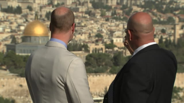 Exterior shots of Prince William as he is shown the view from the Mount of Olives by a guide including Temple Mount and the Western Wall in the...