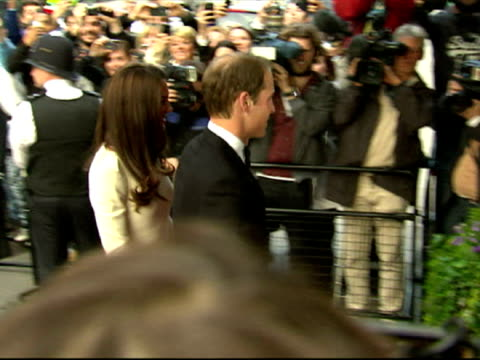 exterior shots of prince william catherine duchess of cambridge arrive at the thirty club together at claridge's hotel catherine wears a split cream... - duchess of cambridge stock videos and b-roll footage