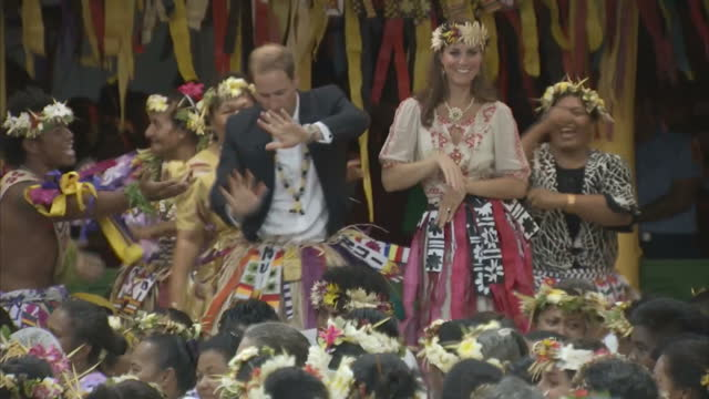 exterior shots of prince william catherine duke duchess of cambridge dancing with local ladies at a vaiku falekaupule ceremony during the royal... - tradition stock videos & royalty-free footage